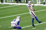 Buffalo Bills kicker Tyler Bass, right, looks after his eighth field goal-attempt of the day during the second half of an NFL football game against the New York Jets, Sunday, Oct. 25, 2020, in East Rutherford, N.J. (AP Photo/Frank Franklin II)