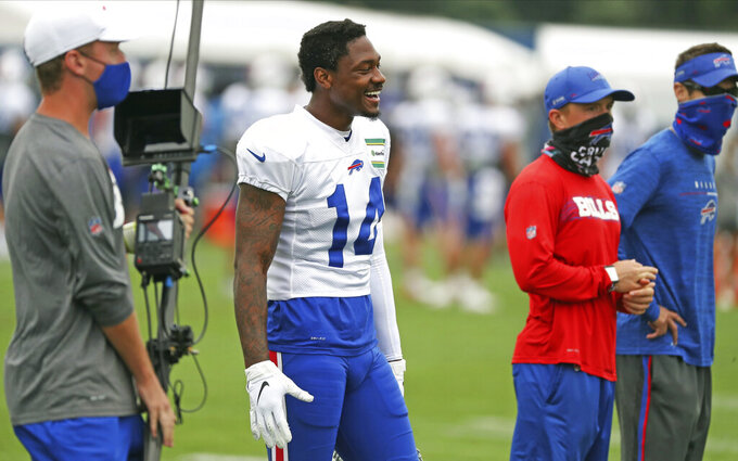 Buffalo Bills wide receiver Stefon Diggs (14) smiles during an NFL football training camp in Orchard Park, N.Y., Tuesday, Aug. 25, 2020. (James P. McCoy/Buffalo News via AP, Pool)