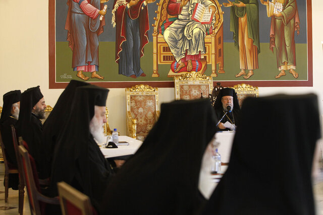 The head of Cyprus Orthodox Church Archbishop Chrysostomos II, facing, presides over a meeting of other bishops composing the Holy Synod, the Church's highest decision-making body at the Church's headquarters in the capital Nicosia, Cyprus, on Monday, Nov. 23, 2020. The Holy Synod convened to discuss issues relating to the Cyprus Church's position on the independence of the Ukrainian Orthodox Church. (AP Photo/Petros Karadjias)