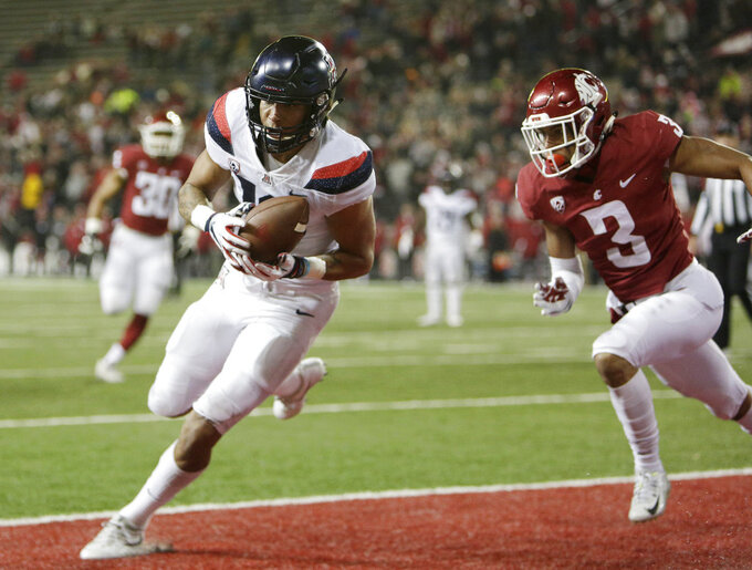 Arizona wide receiver Shawn Poindexter, left, catches a pass for a touchdown in front of Washington State cornerback Darrien Molton (3) during the second half of an NCAA college football game in Pullman, Wash., Saturday, Nov. 17, 2018. Washington State won 69-28. (AP Photo/Young Kwak)