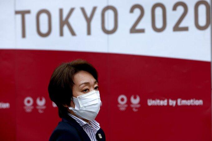 Tokyo 2020 president Seiko Hashimoto looks on after the five-party meeting in Tokyo, Thursday, July 8, 2021. (Behrouz Mehri/Pool Photo via AP)