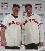 New York Yankees shortstop Derek Jeter, right, and Colorado Rockies outfielder Larry Walker pose after receiving their Baseball Hall of Fame Jerseys, Wednesday Jan. 22, 2020, during a news conference in New York. Jeter and Walker will both join the 2020 Hall o Fame class. (AP Photo/Bebeto Matthews)