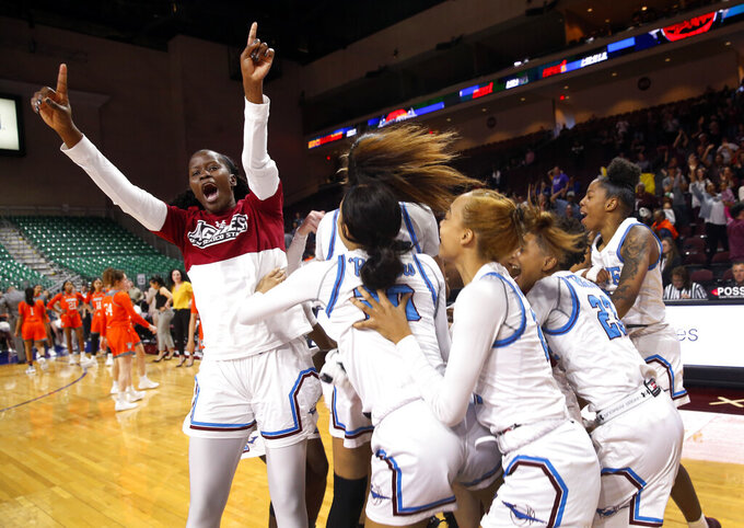 New Mexico State players celebrate after defeating Texas-Rio Grande Valley 76-73 in double overtime during an NCAA college basketball Western Athletic Conference Women's Tournament championship game Saturday, March 16, 2019, in Las Vegas. (AP Photo/Steve Marcus)