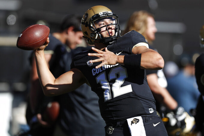 Colorado quarterback Steven Montez warms up before an NCAA college football game against Stanford, Saturday, Nov. 9, 2019, in Boulder, Colo. (AP Photo/David Zalubowski)