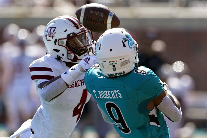 Massachusetts defensive back Noah Boykin breaks up a pass intended for Coastal Carolina wide receiver Tyler Roberts during the second half of an NCAA college football game on Saturday, Sept. 25, 2021, in Conway, S.C. (AP Photo/Chris Carlson)