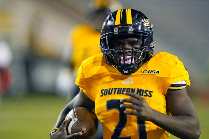 Southern Mississippi running back Frank Gore Jr. runs 73 yards for a touchdown during the first half of the tema's NCAA college football game against Florida Atlantic, Thursday, Dec. 10, 2020, in Hattiesburg, Miss. (AP Photo/Rogelio V. Solis)