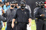 Jacksonville Jaguars head coach Doug Marrone, center, walks the sidelines during the first half of an NFL football game against the Miami Dolphins, Thursday, Sept. 24, 2020, in Jacksonville, Fla. (AP Photo/Stephen B. Morton)
