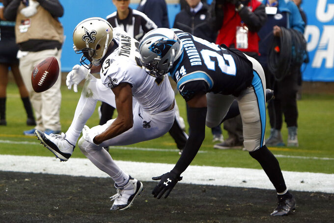 Carolina Panthers cornerback James Bradberry (24) breaks up a pass intended for New Orleans Saints wide receiver Michael Thomas (13) during the first half of an NFL football game in Charlotte, N.C., Sunday, Dec. 29, 2019. (AP Photo/Brian Blanco)