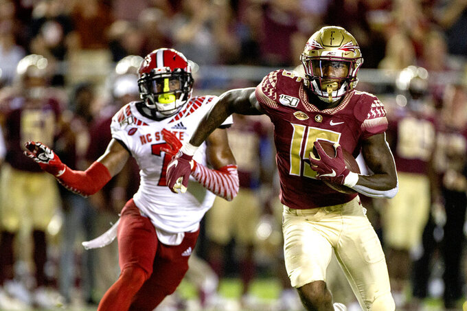 Florida State wide receiver Tamorrion Terry (15) outruns North Carolina State cornerback Chris Ingram (7) to the end zone for a touchdown in the first half of an NCAA college football game in Tallahassee, Fla., Saturday, Sept. 28, 2019. (AP Photo/Mark Wallheiser)