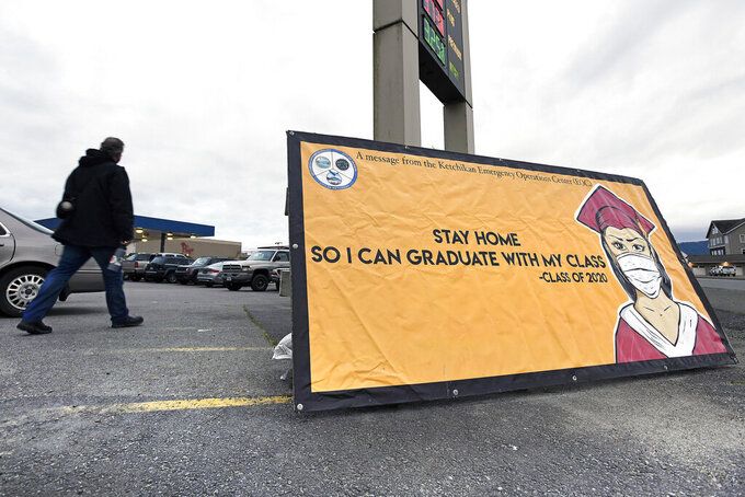 A banner designed last year for the Kayhi Class of 2020 by Ketchikan artist Matt Hamilton is on display at the intersection of Jefferson Way and Tongass Avenue in Ketchikan, Alaska on Tuesday, May 11, 2021. Restaurants, bars and gyms in the Alaska port town of Ketchikan have been asked to close as officials attempt to slow the spread of COVID-19 after the city's pandemic risk level was raised to its highest level. (Dustin Safranek/Ketchikan Daily News via AP)