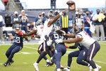 Houston Texans quarterback Deshaun Watson (4) passes against the Tennessee Titans in the first half of an NFL football game Sunday, Oct. 18, 2020, in Nashville, Tenn. (AP Photo/Mark Zaleski)