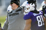 Northwestern head coach Pat Fitzgerald, left, celebrates with Northwestern wide receiver Ramaud Chiaokhia-Bowman (81) after Kyric McGowan scored a touchdown on a 79-yard run during the first half of an NCAA college football game against Purdue, Saturday, Nov. 9, 2019, in Evanston, Ill. Purdue won 24-22. (AP Photo/Paul Beaty)