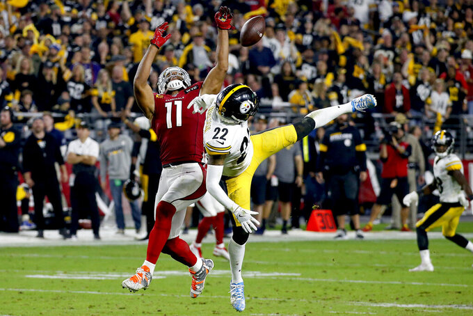Pittsburgh Steelers cornerback Steven Nelson (22) breaks up a pass to Arizona Cardinals wide receiver Larry Fitzgerald (11) during the second half of an NFL football game, Sunday, Dec. 8, 2019, in Glendale, Ariz. The Steelers won 23-17. (AP Photo/Ross D. Franklin)