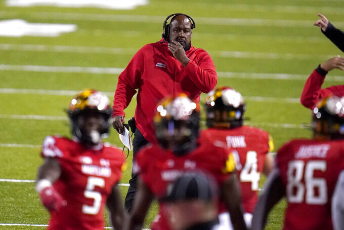 Maryland head coach Michael Locksey, top, looks on during the second half of an NCAA college football game against Minnesota, Friday, Oct. 30, 2020, in College Park, Md. (AP Photo/Julio Cortez)