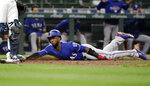 Texas Rangers' Jurickson Profar slides safely in to home to score in the ninth inning of a baseball game Tuesday, May 15, 2018, in Seattle. (AP Photo/Elaine Thompson)