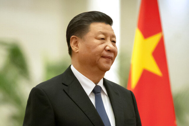 FILE - In this Jan. 6, 2020, file photo, Chinese President Xi Jinping stands during a welcome ceremony for Kiribati's President Taneti Maamau at the Great Hall of the People in Beijing.  Xi will visit neighboring Myanmar amid efforts to strengthen relations with members of the Association of Southeast Asian Nations. (AP Photo/Mark Schiefelbein, File)