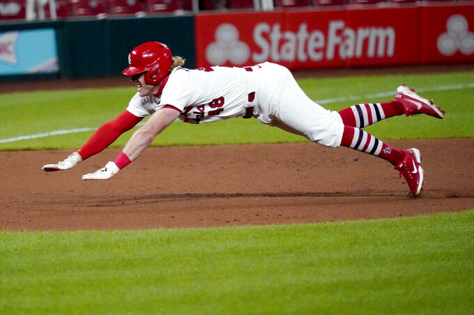 St. Louis Cardinals' Harrison Bader dives into third for a triple during the ninth inning of a baseball game against the Kansas City Royals Tuesday, Aug. 25, 2020, in St. Louis. (AP Photo/Jeff Roberson)