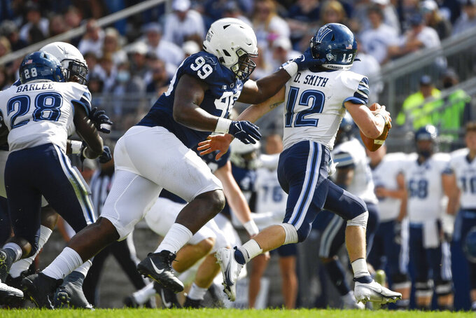 Penn State defensive tackle Coziah Izzard (99) sacks Villanova quarterback Daniel Smith (12) during the fourth quarter of an NCAA college football game in State College, Pa., on Saturday, Sept. 25, 2021. Penn State defeated Villanova 38-17. (AP Photo/Barry Reeger)