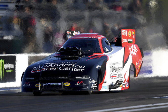 In this photo provided by the NHRA, Tommy Johnson Jr. drives in Funny Car at the Mopar Express Lane NHRA Midwest Nationals drag races at World Wide Technology Raceway on Sunday, Oct. 4, 2020, in Madison, Ill. (Marc Gewertz/NHRA via AP)