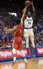 Kansas guard Lagerald Vick (24) shoots a three-point basket over Louisiana Lafayette forward Malik Marquetti (1) during the first half of an NCAA college basketball game in Lawrence, Kan., Friday, Nov. 16, 2018. (AP Photo/Orlin Wagner)
