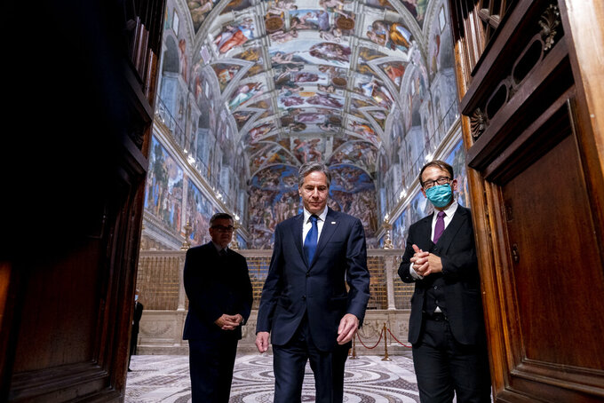 Secretary of State Antony Blinken, center, accompanied by tour guide Alessandro Conforti, right, and Chargé d'Affaires of the U.S. Embassy to the Holy See Patrick Connell, left, gets a tour of the Sistine Chapel at the Vatican in Rome, Monday, June 28, 2021. Blinken is on a week long trip in Europe traveling to Germany, France and Italy. (AP Photo/Andrew Harnik, Pool)