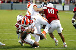 North Carolina State's Savion Jackson (90) tackles Clemson's D.J. Uiagalelei (5) as the left leg of Clemson running back Will Shipley (1) gets caught with North Carolina State's Tanner Ingle (10) also defending during the second half of an NCAA college football game in Raleigh, N.C., Saturday, Sept. 25, 2021. (AP Photo/Karl B DeBlaker)