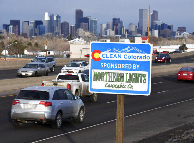 In this Feb. 6, 2020, photo, a Clean Colorado highway sign sponsored by the Northern Lights Cannabis Co. is displayed on eastbound 6th Avenue west of Sheridan Blvd. in Denver. (Andy Cross/The Denver Post via AP)