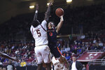 Virginia guard Kihei Clark (0) goesto the basket as he is defended by Boston College forward Jay Heath during the first half of an NCAA college basketball game Tuesday, Jan. 7, 2020 in Boston. (AP Photo/Charles Krupa)