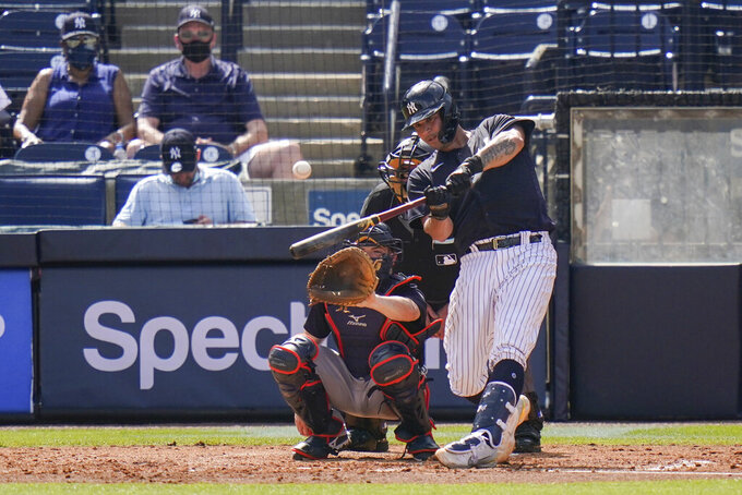 New York Yankees' Gary Sanchez hits a home run during the third inning of a spring baseball game against the Detroit Tigers, Monday, March 1, 2021, in Tampa, Fla. (AP Photo/Frank Franklin II)