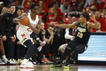 Maryland forward Jalen Smith, left, looks for an open teammate against Purdue guard Nojel Eastern (20) during the first half of an NCAA college basketball game, Saturday, Jan. 18, 2020, in College Park, Md. (AP Photo/Julio Cortez)