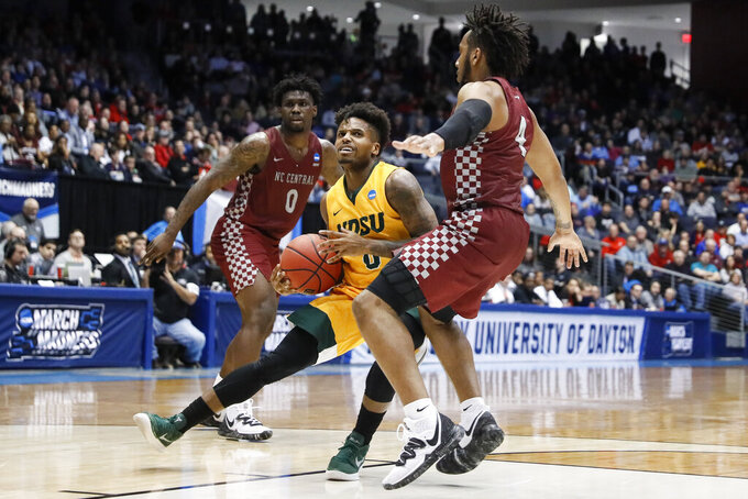 North Dakota State's Vinnie Shahid, center, drives against North Carolina Central's Jordan Perkins (4) during the second half of a First Four game of the NCAA men's college basketball tournament, Wednesday, March 20, 2019, in Dayton, Ohio. (AP Photo/John Minchillo)