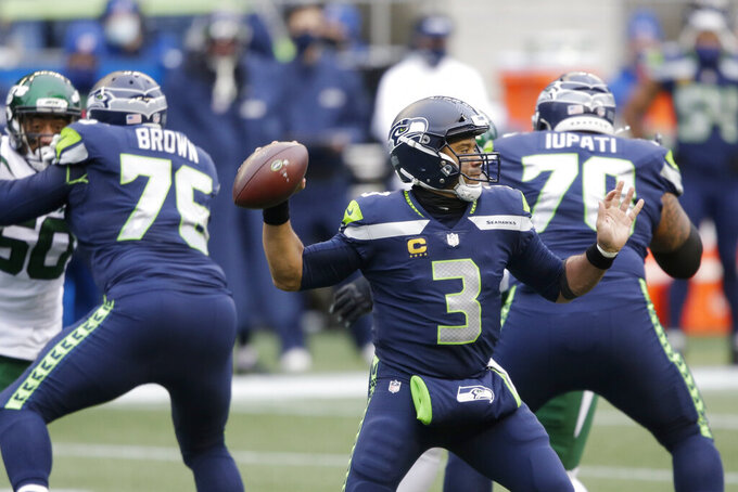 Seattle Seahawks quarterback Russell Wilson (3) throws against the New York Jets during the first half of an NFL football game, Sunday, Dec. 13, 2020, in Seattle. (AP Photo/Lindsey Wasson)