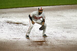 Rain water is accumulated in the infield dirt as Baltimore Orioles third baseman Kelvin Gutierrez waits for a pitch to the Kansas City Royals during the sixth inning of a baseball game, Thursday, Sept. 9, 2021, in Baltimore. (AP Photo/Julio Cortez)