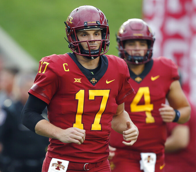 FILE - In this Sept. 1, 2018, file photo, Iowa State quarterback Kyle Kempt runs out on the field before an NCAA college football game against South Dakota State, in Ames, Iowa. Kempt got a sixth college season after taking over as Iowa State's starting quarterback the middle of last season. (AP Photo/Matthew Putney, File)