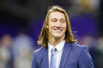 FILE - Clemson quarterback Trevor Lawrence arrives before the NCAA College Football Playoff national championship game against LSU in New Orleans, in this Monday, Jan. 13, 2020, file photo. Lawrence is a likely top pick in the NFL Draft, April 29-May 1, 2021, in Cleveland. (AP Photo/David J. Phillip, File)