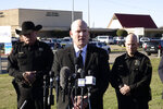 Texas Department of Public Safety regional director Jeff Williams speaks during a news conference, as Tarrant County Sheriff Bill Waybourn, left, and White Settlement Police Chief J.P. Bevering, right, stand behind him, Sunday, Dec. 29, 2019, in front of West Freeway Church of Christ, in White Settlement, Texas. Police say congregants shot and killed a man who opened fire at the church. (AP Photo/David Kent)