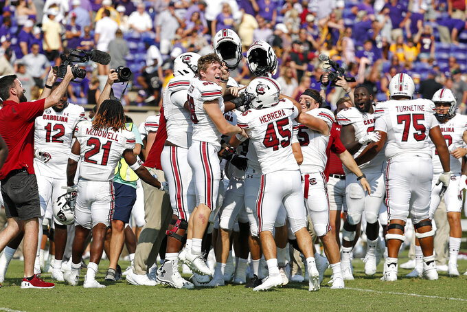 South Carolina celebrates a game winning field goal as time expired in an NCAA college football game over East Carolina in Greenville, N.C., Saturday, Sept. 11, 2021. (AP Photo/Karl B DeBlaker)