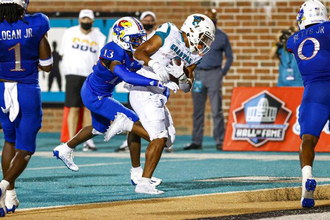 Coastal Carolina running back Reese White runs for a touchdown as Kansas cornerback Ra'Mello Dotson defends during the second half of an NCAA college football game in Conway, S.C., Friday, Sept. 10, 2021. Coastal Carolina won 49-22. (AP Photo/Nell Redmond)