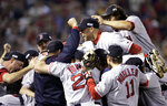 FILE - In this Oct. 27, 2004, file photo, Boston Red Sox players celebrate after defeating the St. Louis Cardinals in Game 4 to win the World Series in St. Louis. The Cardinals and the Red Sox would have had one of their rare regular-season series this week. They have met in four different World Series. They would have played a three-game series at Fenway Park this week if not for the coronavirus pandemic. (AP Photo/Al Behrman, File)