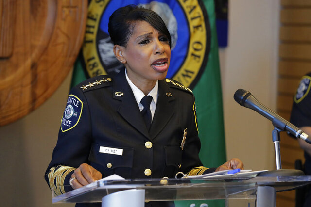Seattle Police Chief Carmen Best speaks during a news conference, Tuesday, Aug. 11, 2020, in Seattle. Best, the first Black woman to lead Seattle's police department, announced she will be stepping down in September following cuts to her budget that would reduce the department by as many as 100 officers. (AP Photo/Ted S. Warren)