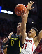 Oregon guard Will Richardson (0) shoots in front of Arizona forward Ira Lee in the first half of an NCAA college basketball game, Thursday, Jan. 17, 2019, in Tucson, Ariz. (AP Photo/Rick Scuteri)