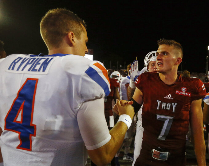 Boise State quarterback Brett Rypien (4) shakes hands with Troy quarterback Kaleb Barker (7) after an NCAA college football game, Saturday, Sept. 1, 2018, in Troy, Ala. (AP Photo/Butch Dill)