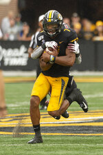 Missouri quarterback Kelly Bryant is tackled by South Carolina defensive back Jammie Robinson during the second quarter of an NCAA college football game, Saturday, Sept. 21, 2019, in Columbia, Mo. (AP Photo/L.G. Patterson)