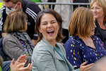 FILE - In this Monday, Sept.20, 2021 file photo, top candidate for chancellor of the Greens Annalena Baerbock laughs during an election campaign in Mainz, Germany. Germany's closely fought election on Sunday will set the direction of the European Union's most populous country after 16 years under Angela Merkel, whose party is scrambling to avoid defeat by its center-left rivals after a rollercoaster campaign. (AP Photo/Michael Probst, File)
