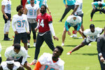 Miami Dolphins quarterback Jacoby Brissett (14) does drills at the team's NFL football training facility, Wednesday, May 26, 2021, in Davie, Fla. (AP Photo/Lynne Sladky)