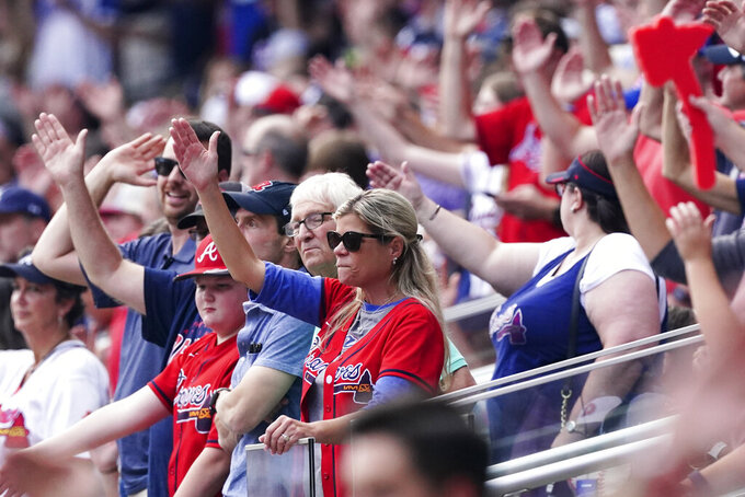 Atlanta Braves fan gesture during the first inning of Game 4 of a baseball National League Division Series between the Atlanta Braves and the Milwaukee Brewers, Tuesday, Oct. 12, 2021, in Atlanta. (AP Photo/John Bazemore)