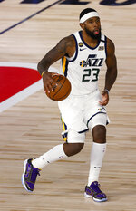 Utah Jazz's Royce O'Neale brings the ball up during the third quarter against the Denver Nuggets in Game 5 of an NBA basketball first-round playoff series, Tuesday, Aug. 25, 2020, in Lake Buena Vista, Fla. (Mike Ehrmann/Pool Photo via AP)