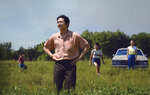 This image released by A24 shows Steven Yeun, foreground, in a scene from