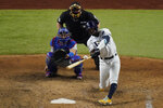 Tampa Bay Rays' Randy Arozarena hits home run during the ninth inning in Game 3 of the baseball World Series against the Los Angeles Dodgers Friday, Oct. 23, 2020, in Arlington, Texas. Dodgers beat the Rays 6-2 to lead the series 2-1 games. (AP Photo/Sue Ogrocki)