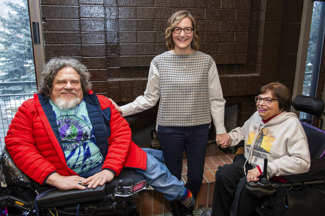 FILE - This Jan. 24, 2020 file photo shows co-directors Jim LeBrecht, left, and Nicole Newnham, center, from the documentary